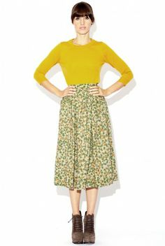 YSL High Waisted Green Print Skirt with Matching Belt from the early 1980s. It is styled with a J.Crew sweater and Elizabeth & James moxie boots.