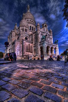 Sacré-Cœur, Paris. The Sacré-Cœur Basilica was designed by Paul Abadie. Construction began in 1875 and was finished in 1914. It was consecrated after the end of World War I in 1919.