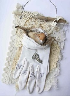 "beautiful - bird nest in the ""pocket"" of a vintage glove (I'm imagining it is anyway) backed with lace, mounted on driftwood, hung from wire loop - perfectly shabby and wonderful! I love this!  *******************************************    via Flickr - #shabby #chic #bird #vintage #nature #crafts -"