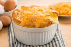"""Soufflé roughly translates to """"full of air,"""" with egg whites giving soufflés their signature puffiness. Cheesy and fluffy, this cheese and bread version certainly won't leave you feeling deflated. Brunch Recipes, Gourmet Recipes, Low Carb Recipes, Baking Recipes, Snack Recipes, Egg Recipes, Breakfast Recipes, Recipies, Side Dishes"""
