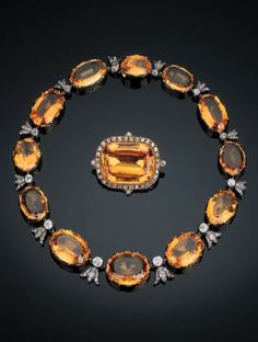 A rare antique topaz and diamond demi-parure, circa 1860. The articulated necklace comprising twelve graduated oval-shaped topaz with old-cut diamond collet and diamond-set trefoil connections, the brooch set with a rectangular cushion-cut topaz within an old-cut diamond surround, mounted in silver and gold.