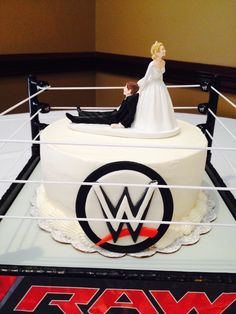 WWE Grooms cake: buttercream iced with topper and fondant details