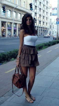 outfit idea. instead of white boob tube, have a tight white cut off bustier top with same brown coloured skirt but instead of a frilly loose skirt, swap it with a high wasted tight skirt that goes to the knees.