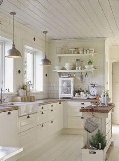Farmhouse white kitchen with a rustic wood topped island. More via http://forcreativejuice.com/elegant-white-kitchen-interior-designs/