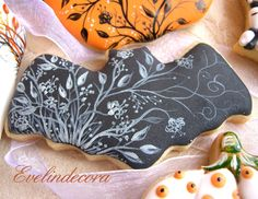 halloween cookies  decorated with royal icing and painted freehand with food coloring gel
