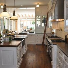 Giannetti Home - kitchens - kitchen ladder, stained wood floors, rustic wood floros, kitchen with rustic floors, kitchen with rustic wood fl...