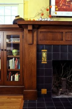 Craftsman Style Design, Pictures, Remodel, Decor and Ideas. Ceramic tile fireplace with art tile and adjacent built-in bookcase/cabinet. Fireplace Remodel, Fireplace Mantle, Fireplace Surrounds, Fireplace Design, Fireplace Ideas, Fireplace Outdoor, Fireplace Decorations, Simple Fireplace, Fireplace Kitchen