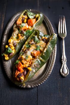Peppers with Black Bean, Corn & Sweet Potato Vegetarian stuffed poblano peppers loaded with salsa, sweet potato, corn and black beans. Easy, minimal ingredients and HEALTHY! Veggie Dishes, Veggie Recipes, Mexican Food Recipes, Whole Food Recipes, Vegetarian Recipes, Dinner Recipes, Cooking Recipes, Healthy Recipes, Vegetarian Cooking