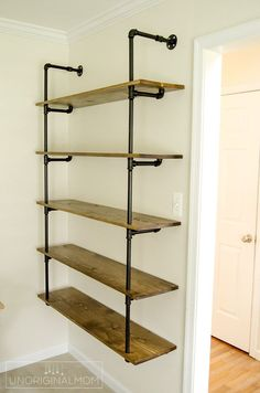 Really detailed step-by-step tutorial to make your own industrial pipe shelving - this is an affordable and fun way to get the Joanna Gaines Fixer Upper style in your own home! Diy Pipe Shelves, Industrial Pipe Shelves, Industrial House, Pipe Shelving, Industrial Farmhouse, Shelves With Pipes, Industrial Office, Galvanized Pipe Shelves, Industrial Style
