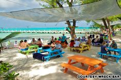 Love the bright colored tables! Wreck Bar, Grand Cayman
