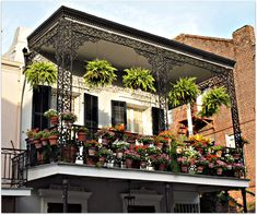 This French Quarter home has a lot of color this morning in July., balcony