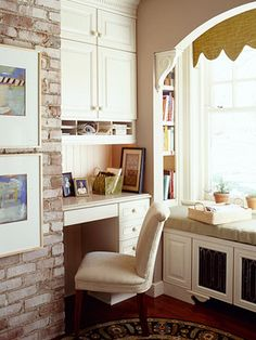 cute desk! and the window seat lifts up to reveal a file holder
