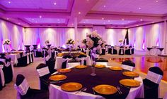 Omg!! I want my wedding colors to be Purple & Yellow! Beautiful Reception venue!