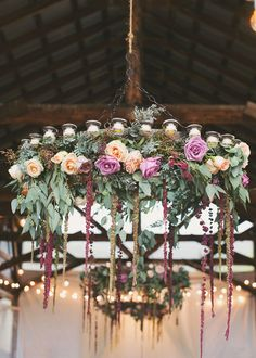 Obsessed with these! // The barn's décor included rustic round chandeliers adorned with flowers and greenery. Sara says the chandeliers were her favorite design detail of the wedding. Plum Gold Wedding, Floral Wedding, Rustic Wedding, Wedding Flowers, Farm Wedding, Round Chandelier, Flower Chandelier, Chandeliers, Lustre Floral