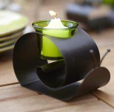 """SUNNY SNAIL VOTIVE HOLDER Was $15 Now $12 WHILE SUPPLIES LAST  Cute critter wins your heart with its shapely curves and miniature antennae. Glass votive cup holds votives or tealights, sold separately. Weather-resistant bronze-finished metal. 3½""""h, 5¼""""w.  http://www.partylite.biz/legacy/sites/stevengerard/productcatalog?page=productdetail&sku=P91036&categoryId=55268&showCrumbs=true"""