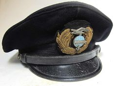 Zeppelin Officers Cap. This reproduction cap has had medium wear and has been aged to look 70+ years old. It has a stained, in places, blue officers cover, the leather sweatband has stains and the wreath and chinstrap show dark tarnishing with age crackling on the chin strap.    http://www.warhats.com/store/p437/German_Zeppelin_Officers_cap_as_worn_by_Officers_and_the_Captain_of_Zeppelins_during_the_NSDAP_period.html   www.warhats.com