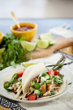 {Fish tacos with avocado crema.}