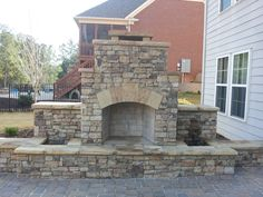 Outdoor Stone Fireplace with Water Feature