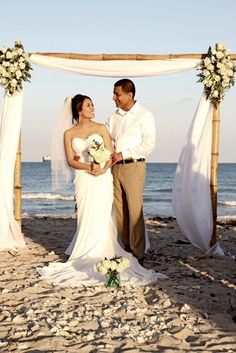 Pretty and simple wedding arch - maybe use regular wood instead of that bamboo looking wood (where would we buy that?)