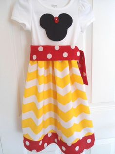 Custom Boutique Clothing Minnie Mouse Girls Chevron Disney Dress. Im sure Maris will refuse to wear everything but a dress.