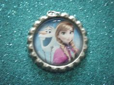Frozen Anna and Olaf bottle cap pendant on silver by indieodyssey, $5.00