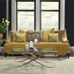 Golden yellow couch against black walls.