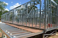 Boxspan deck frame with Step Down from main steel frame house. Designed and Manufacutured by Spantec as a complete Steel Floor Frame Kit. Steel Framing, Deck Framing, Floor Framing, Steel Frame House, Steel House, Carport Kits, Structural Insulated Panels, Diy Deck, Deck Plans