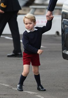 An impatient George looked at the plane, shuffled his feet and pulled on his father's hand before they all boarded it