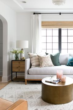 Bright, Eclectic Living Room of the Denver Tudor Project | Studio McGee