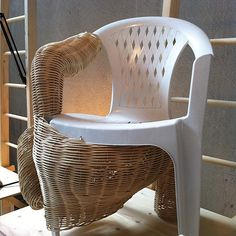 """From Ventura Lambrate - Giulia Cavazzani describes Viminibidi as a """"parasite"""" that can grow on ordinary plastic chairs found in gardens giving them extra functions – this one features a magazine pocket on the far side. I liked the combination of a mass produced and ubiquitous object and the hand woven wicker... to me the chair looks like it is shedding it's skin or cocoon"""