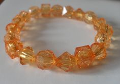 Amber Coloured Faceted Elasticated Bracelet by JustJoJewellery, £4.00