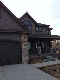 Love this!!!! house exterior Sherwin Williams Gauntlet Gray and Sherwin Williams Urbane Bronze trim. Prestige Drystack stone