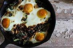 Nutrition Stripped | Baked Eggs with Garlic Kale and Sun-dried Tomatoes | http://nutritionstripped.com