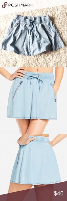 NWT FABLETICS Chambray denim Skirt Brand new with tags. Chambray skirt with drawstring waist and zipper pockets. Fabletics Skirts