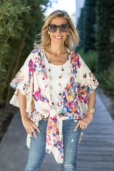 Our Floral Print Duster is a fun piece for spring and you can wear it loose or tied at the waist. Styled here with our Ivory Cold Shoulder Top and Black and Multi Color Clover Necklace - All part of our weekend Flash Sale!.Get 15% off all featured items with code FS56 plus Free US Shipping www.jacketsociety.com
