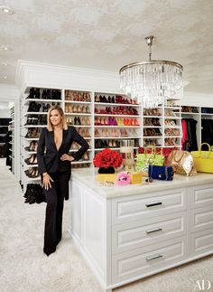 Khloé in her vast master closet; the chandelier is by RH, and the ceiling is lined in a Schumacher wallpaper. wallpaper Khloé and Kourtney Kardashian Realize Their Dream Homes in California Master Closet, Closet Bedroom, Walk In Closet, Master Bedroom, Master Bath, Closet Space, Master Suite, Celebrity Closets, Celebrity Houses