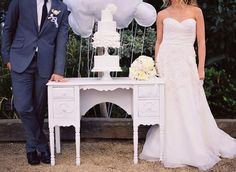 I like her dress and the use of the old desk as a table! Cloud 9 wedding