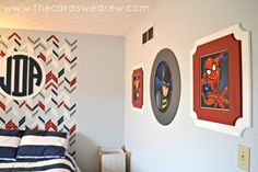 Project Nursery - boys superhero bedroom with frames.  Love the herringbone accent!