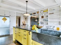 A great way to use our soapstone laundry sinks! eclectic kitchen Eclectic Kitchen