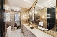 The master bath in Cameron Diaz's Manhattan apartment features a custom-designed vanity | www.bocadolobo.com  #bocadolobo #luxuryfurniture #exclusivedesign #interiordesign #designideas #luxuryhomes