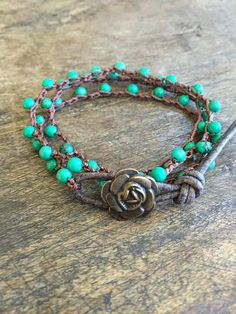 Beautiful turquoise beads are crocheted onto dark brown nylon cord featuring a lovely antiqued bronze flower closure and distressed brown