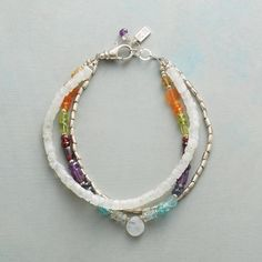 """VIVA BRACELET--The milky glow of moonstone and sterling silver's cool gleam offer striking contrast to the vibrant colors of peridot, citrine, carnelian, garnet, amethyst, iolite, aquamarine, and apatite. Sterling lobster clasp. USA. Exclusive. 7-1/2"""" to 8""""L."""