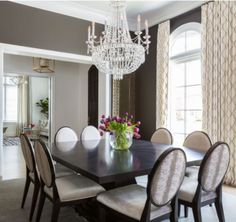 Dining room essential number two: CHANDELIERS! A chandelier in your dining room should be one of, if not the most, striking statement piece in your home! There is no other item – other than a roaring fire – that warms the look of your dining room for the holidays.