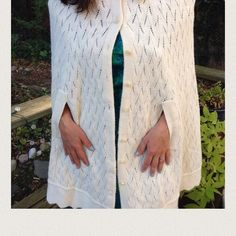 """Vintage knitted white cape In excellent vintage condition. It lies on the shoulders and you insert your hands through the slits at the waist. All buttons intact. Measurements lying flat: bust 23"""", shoulder seam to hem 32"""". Vintage Sweaters"""