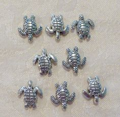 This item is a pack of TEN solid metal Turtle Beads. Each bead is 18mm x 16mm in size. Follow me on facebook @ Jersey Shore Beads. INTERNATIONAL BUYERS: PLEASE CONTACT ME IF YOU WISH TO ORDER AND I WILL GIVE YOU THE SHIPPING COSTS FOR ITEMS YOU WISH TO PURCHASE.
