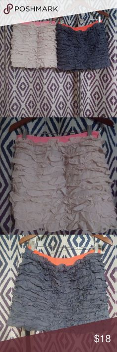 """2 J. Crew skirts I am selling TWO skirts for less than the price of one at J. Crew!! Fun, flirty ruffled mini skirts. One is white with a pink waist band and the other is a navy blue with an orange waist band. If you want to buy just one, let me know. 14 1/2 """" L. J. Crew Skirts Mini"""