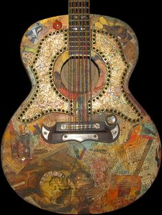 This is an old guitar I collaged several years ago.