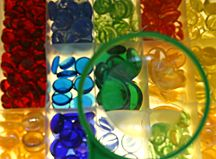 Children can learn about color, relection and transparency with glass beads on a light table.