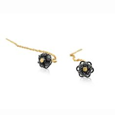 These exquisite threaded Zeeland button earrings are made in 14k yellow gold and oxidised sterling silver. The detailing is exceptional. They are a stud earring with long chain drop at back. A contemporary twist on a traditional dutch earring.