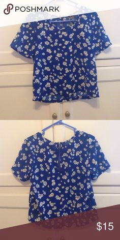 Blue daisy blouse Adorable blouse with a daisy print. Great shape, only worn a couple times! Very slightly cropped *brand used for exposure* Brandy Melville Tops Blouses